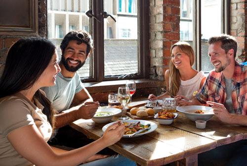 Group of people eating food in restaurant